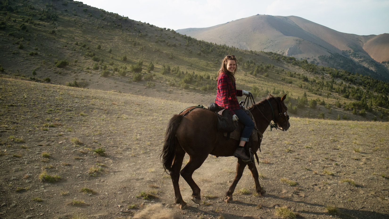 Molly riding in Chilcotin Mountains